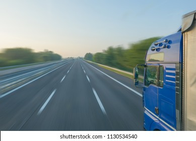 Transportation concept, motion blur of truck driving on a highway