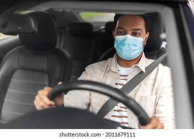 transportation, health and people concept - male indian driver wearing face protective mask for protection from virus disease driving taxi car