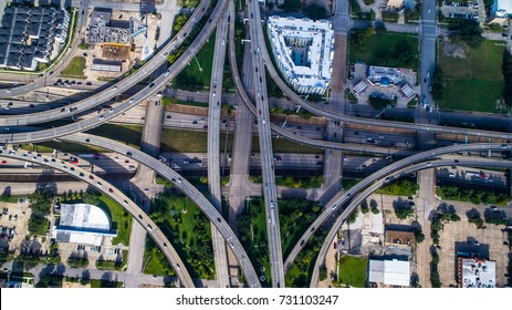 Transportation highway interstate urban sprawl congestion on Texas roads. Rush hour traffic made worse from suburban urban sprawl. Interchange and overpass takes you on a ride in Houston , Texas