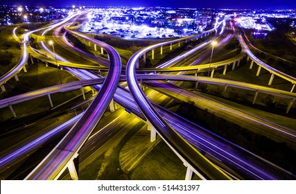 transportation highway system in America. time lapse , long exposure , urban sprawl interstate and interchange loops and turnarounds on highway 183 and Mopac expressway in Austin Texas