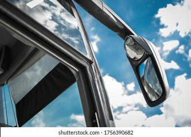 Transportation Industry. International Touring Coach Bus Traveling Concept Photo with Modern Bus Exterior Mirror and Front Door Close Up.