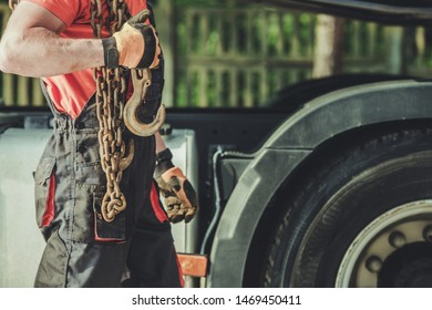 Transportation Industry Worker with Heavy Duty Load Support Chains.