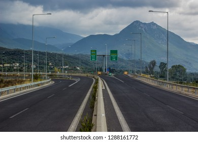 transportation and infrastructure concept of European Union highway car road to Greek cities Sparti, Kalamata and Athens in mountain nature environment and cloudy stormy weather