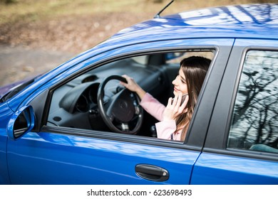 transportation, people, technology and vehicle concept - close up of woman using smartphone while driving car