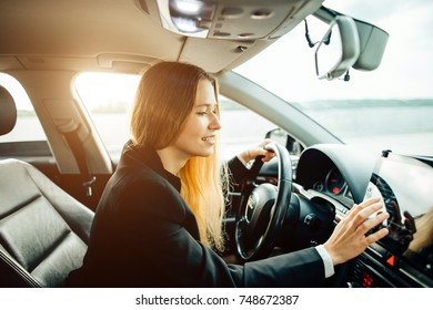 transportation, people and vehicle concept - close up of businesswoman driving car