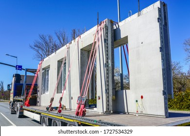 transportation of reinforced concrete precast wall panels for house construction by truck