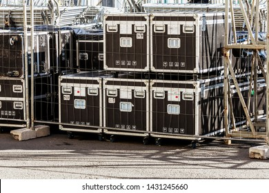 Transportation and storage of concert equipment. Containers and boxes with metal trim on wheels. Carrying crates. transportation of audio and video equipment during the tour