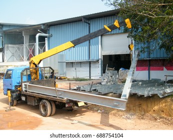 Transportation of structural steel at site.Structural steel loading and unloading by suing Boom Truck.