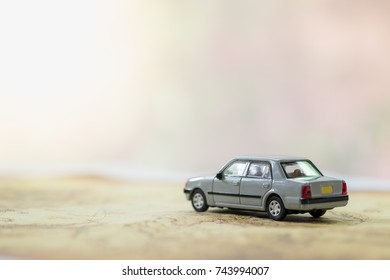 Transportation and travel concept. Mini car toy on world map with copy space.