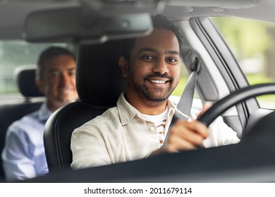 transportation, vehicle and people concept - happy smiling indian male driver driving car with passenger