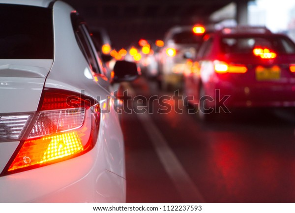 transportation vehicle and traffic concept - Blurred traffic jam and brake light in bangkok, thailand on evening