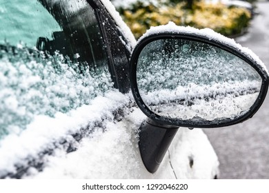 Transportation, winter, weather, vehicle concept. Car's door handle covered in snow and icy rain in winter. Blizzard Snowfall icy rain for weather concept.