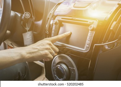 Transportation,technology and vehicle GPS,concept - man using car system control pushing panel button screen interface modern design