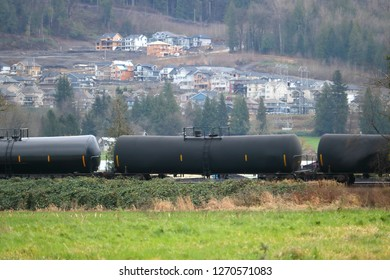 Transporting crude bitumen oil using rail cars through an agricultural rural and populated landscape.