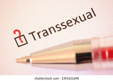 Transsexual - checkbox with a question mark on white paper with pen. Checklist concept.
