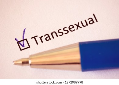 Transsexual - checkbox with a tick on white paper with pen. Checklist concept.
