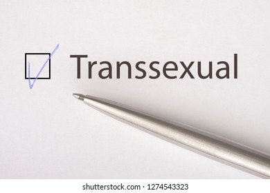 Transsexual - checkbox with a tick on white paper with metal pen. Checklist concept. Close-up