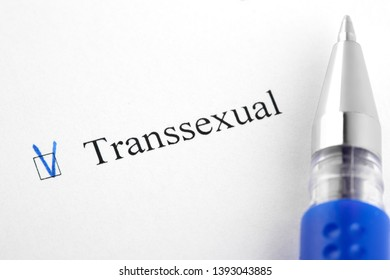 Transsexual. Filling in the questionnaire, documents. The checkboxes are filled with a black pen on a white background. Questionnaire, survey.