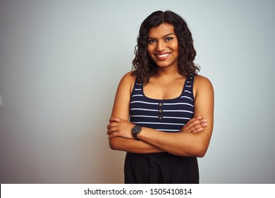 Transsexual transgender woman wearing striped t-shirt over isolated white background happy face smiling with crossed arms looking at the camera. Positive person.