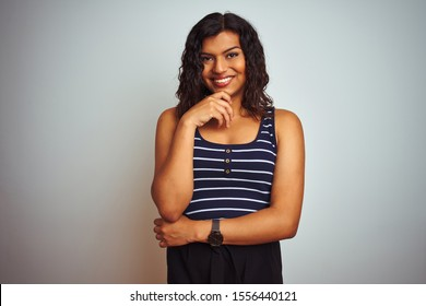 Transsexual transgender woman wearing striped t-shirt over isolated white background with hand on chin thinking about question, pensive expression. Smiling and thoughtful face. Doubt concept.