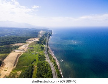 Trans-Siberian Railway on the Baikal lake shore from aerial view