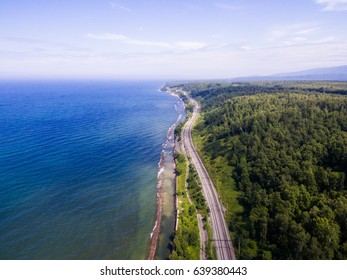Trans-Siberian Railway on the Baikal lake shore from aerial view. the largest freshwater lake