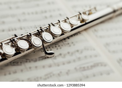 transverse flute on music sheet