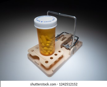 Trap with medical bottle full of pills. Drug addiction concept