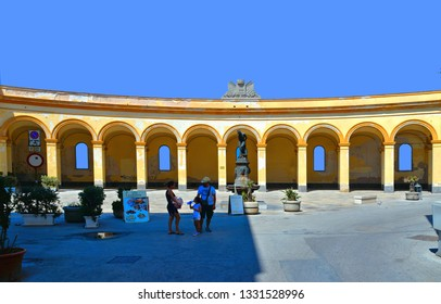 TRAPANI, ITALY 30.08.2018.  View of The square of the old fish market with people and old buildings in historical center of Trapani, Sicily, Italy