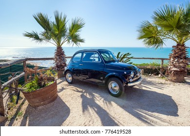Trapani, Italy - October 24, 2016: Rented Fiat 500 near the seaside in Sicily. It is the most popular car offered by rent a car companies in Sicily.