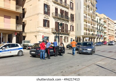 Trapani, Italy - October 4, 2016: Car accident in the city center with police in assessments. Machinery behind crashed into each other.