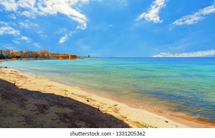 Trapani. Panoramic view of empty paradise turquoise beach near on waterfront and near city harbor, Sicily, Italy.
