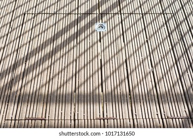 trapdoor in the daylight with shadows forming diagonals
