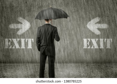 Trapped unhappy businessman is standing in front of wall on a gloomy day and has no way out of his hopeless situation - business concept