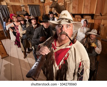 Trapper with rifle over his shoulder in an old western tavern