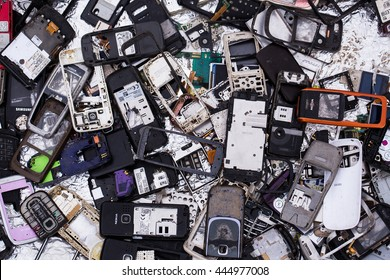 Trash - April 17, 2016: Pile of trash with many old disassembled broken covers parts of mobile phones devices