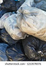trash bags near the dumpster