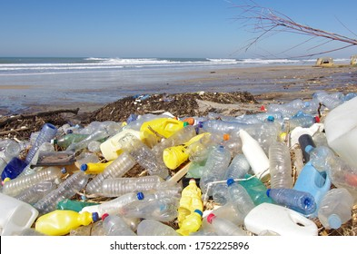 Trash beach pollution with plastic bottles