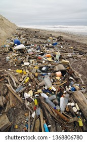 Trash beach pollution. Plastic and wastes on the beach after winter storms. Atlantic west coast of France.