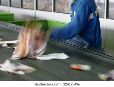 Trash being sorted on conveyor belt, cropped