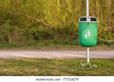 trash bin on a park alley