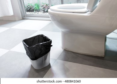 trash can in the toilet