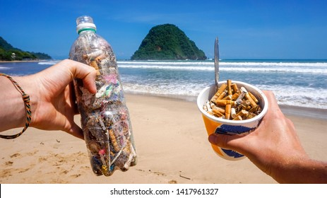 Trash collected from the pictured beach presented in single use plastic items. All rubbish found in the sand and sea. Representing the pollution in our oceans today which kills marine life worldwide