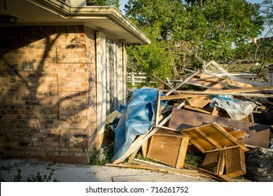 Trash and debris laying outside a Houston home after Hurricane Harvey