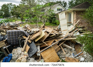 Trash and debris outside of neighborhoods devastated by Hurricane Harvey