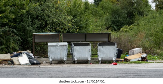 Trash and dumpsters on the side of the road