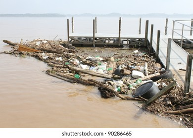 Trash floating in river - Polluted River