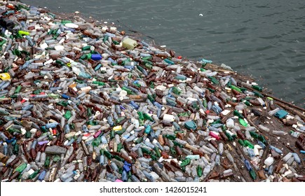 Trash and garbage floating on the surface of the water.