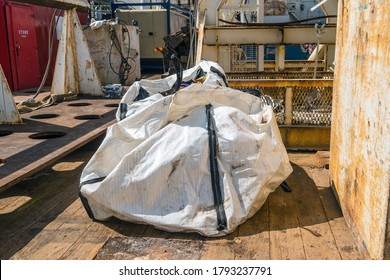 Trash jumbo bag laid on deck of a construction barge during an inspection