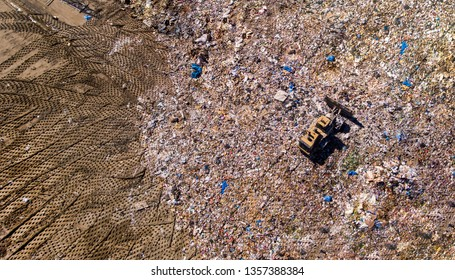 trash at the landfill being flattened out